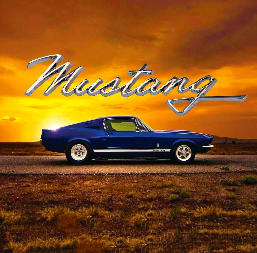 Image of a classic blue GT 500 Mustang against a sunset backdrop