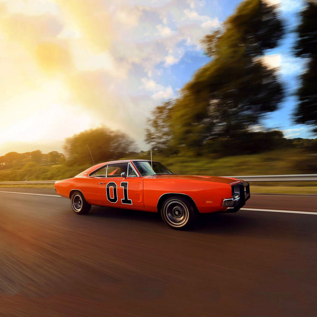Image of The General Lee from the Dukes of Hazzard TV series driving down a road