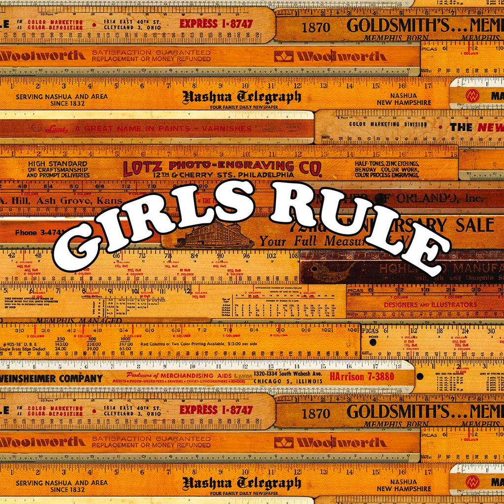 Image of wooden school rulers and the words Girls Rule across it