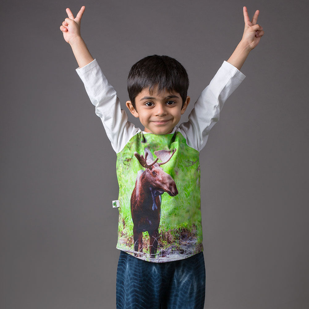 Boy wearing a raglan tee with an image of a moose