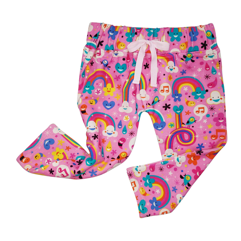 French Terry joggers with all-over print of happy, cartoon rainbows, clouds, flowers and musical notes
