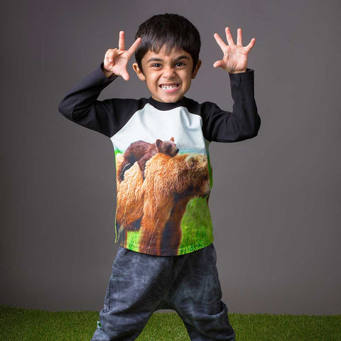 Boy wearing a raglan tee with image of a baby brown bear cub on top of a mama bear