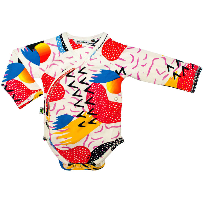 Front view of long sleeve bodysuit with kimono wrap front with a kitschy, pop art print design