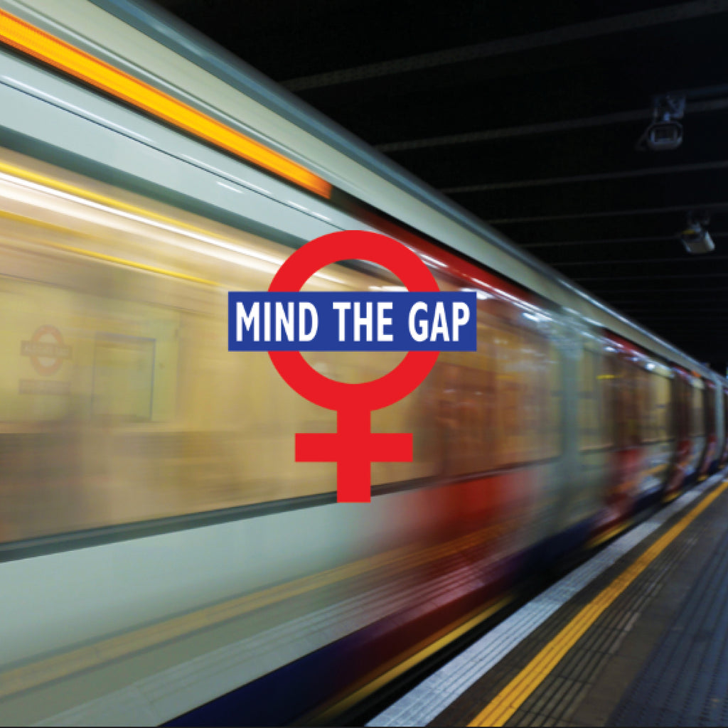 "Image of a London underground subway superimposed with ""Mind The Gap"" and the symbol for female"