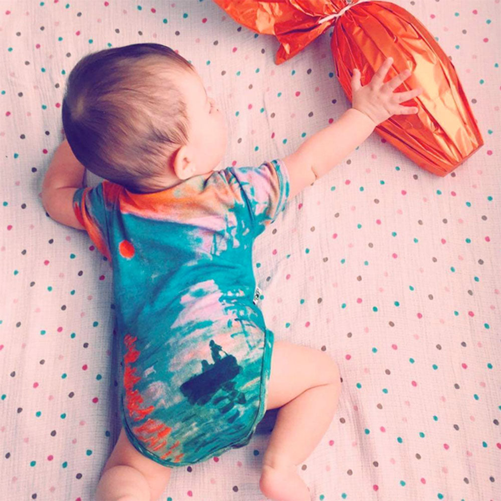 "Baby wearing a short sleeve bodysuit printed with Claude Monet's ""Impression, Sunrise"" painting"