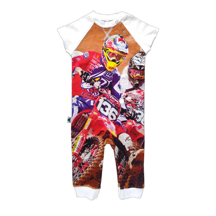 Raglan cut-off romper with an image of motocross participants in action