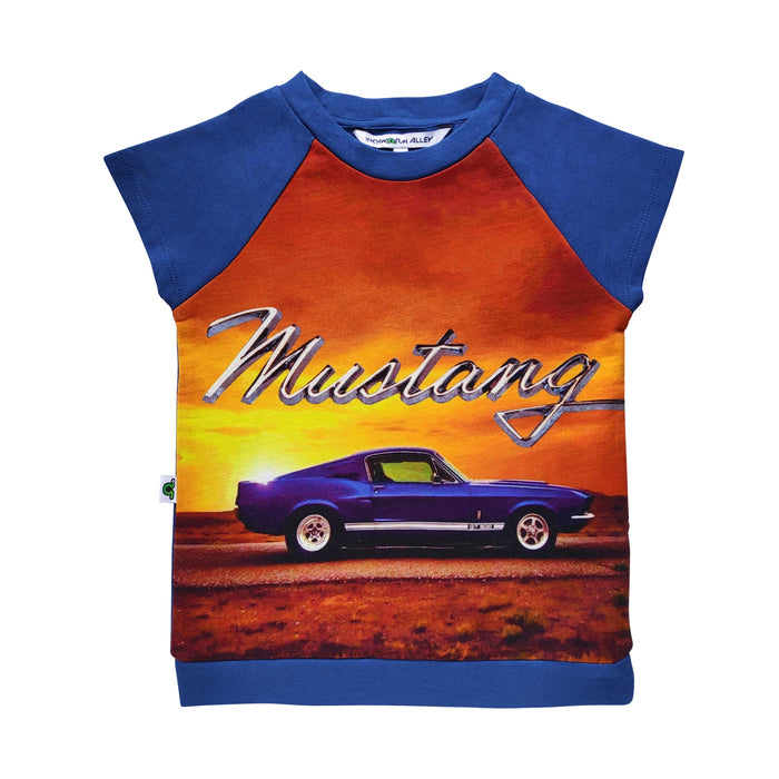 Raglan cut-off tee with the image of classic blue GT 500 Mustang against a sunset backdrop
