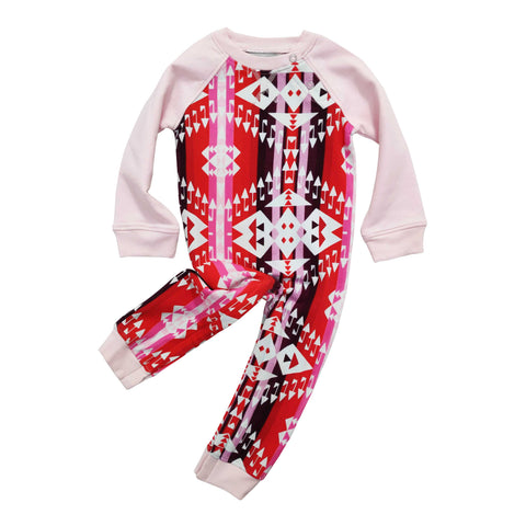 Full sleeve raglan romper with Navajo-inspired design in bright hues of red and pink.