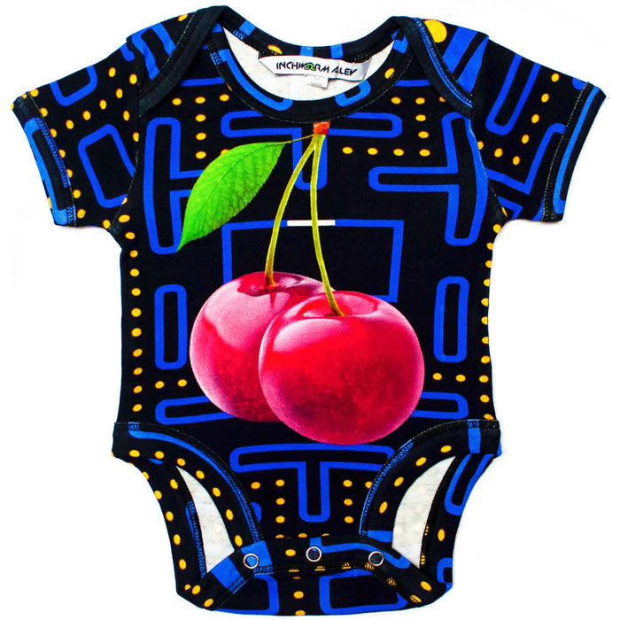 Front view of a short sleeve bodysuit printed with an image of the Pacman arcade game and oversized cherries