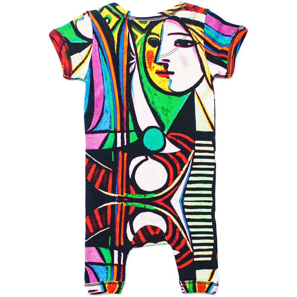 "Back view of a short sleeve romper with shorts printed with Picasso's ""Girl Before A Mirror"""