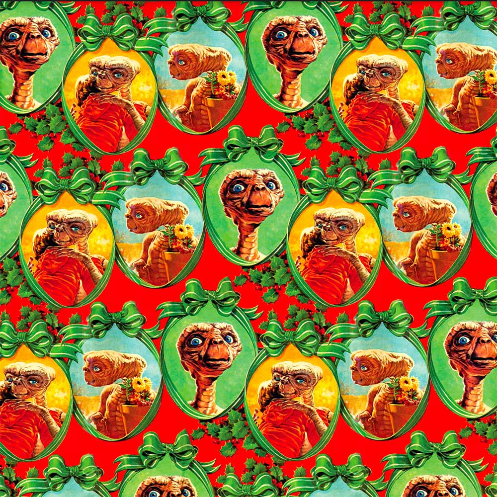 Vintage Christmas wrapping paper featuring E.T.