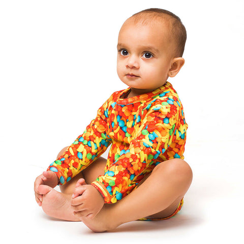 Babh wearing a bodysuit onesie with all-over image of Runts candy