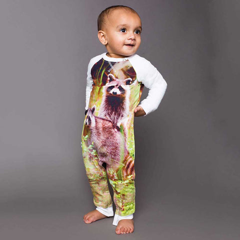 Baby wearing a raglan romper with image of two raccoons