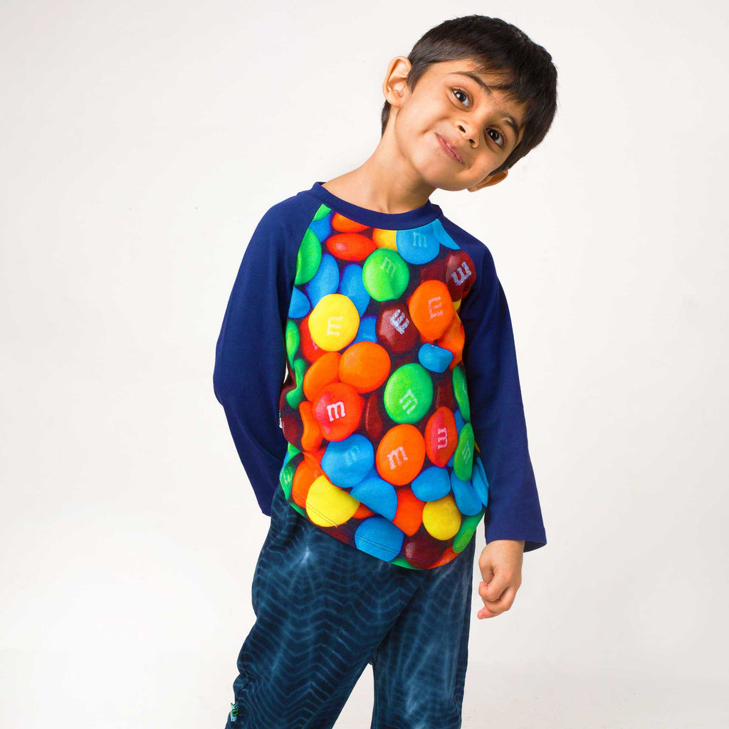 Boy wearing a tee with image of M&M's