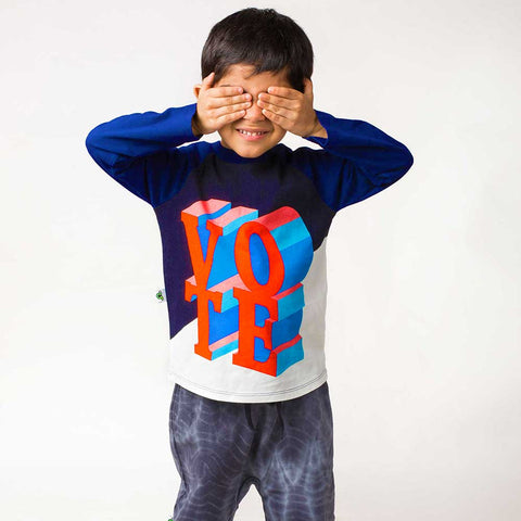 Boy wearing a raglan tee with illustrated VOTE text