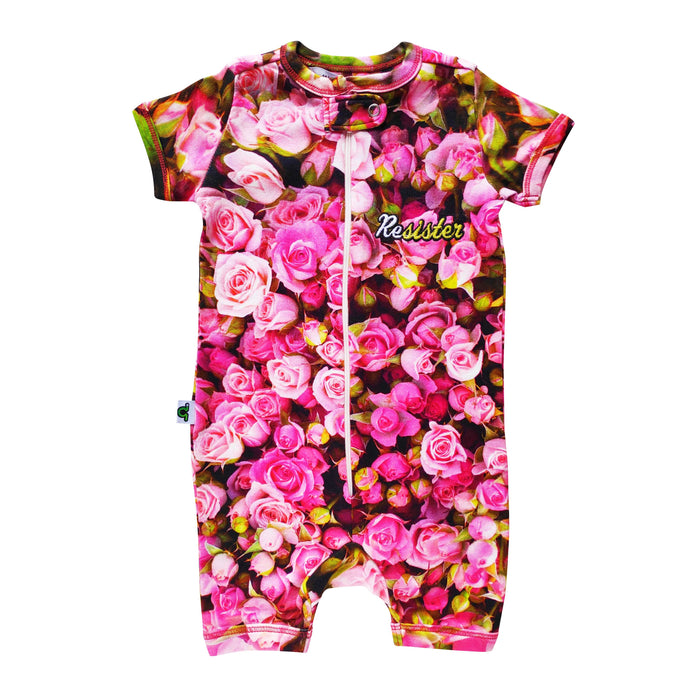 Short sleeve shorts romper with an all-over print of pink roses and the word ReSISTER on the chest