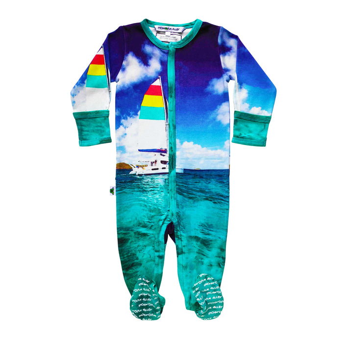 Long sleeve footie with image of a colourful sailboat on tropical waters against a blue sky