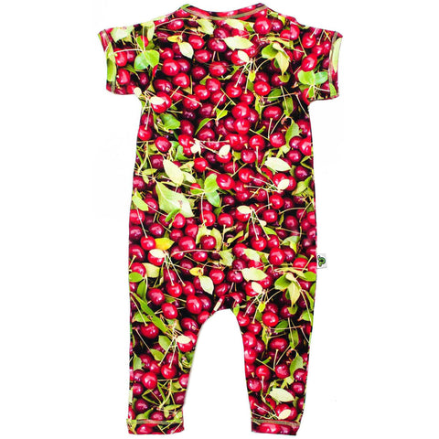 Back view of short sleeve, full leg romper with all-over print of sour cherries