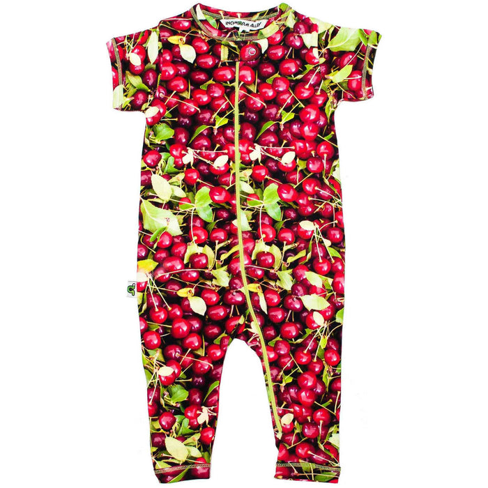 Front view of short sleeve, full leg romper with all-over print of sour cherries