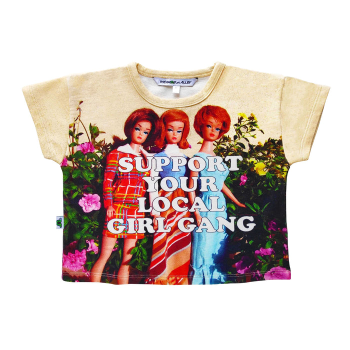 Boxy tee with image of vintage Barbie Dolls against a garden backdrop with the words Support Your Local Girl Gang across the chest