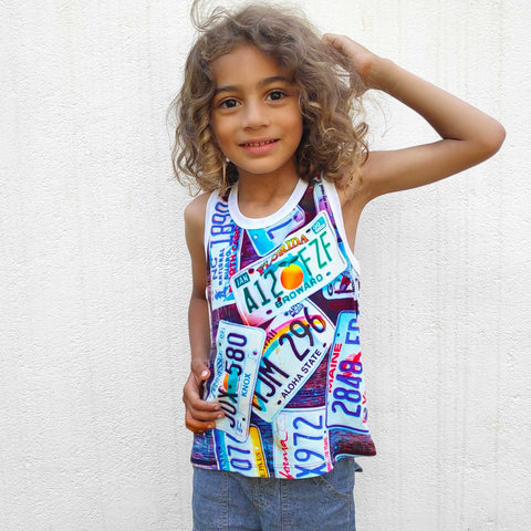 Child wearing a tank top with image of various US license plates