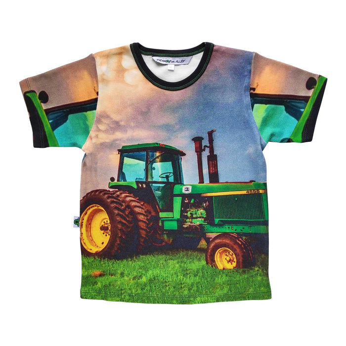 Graphic tee with image of a John Deere tractor against a moody, cloudy sky