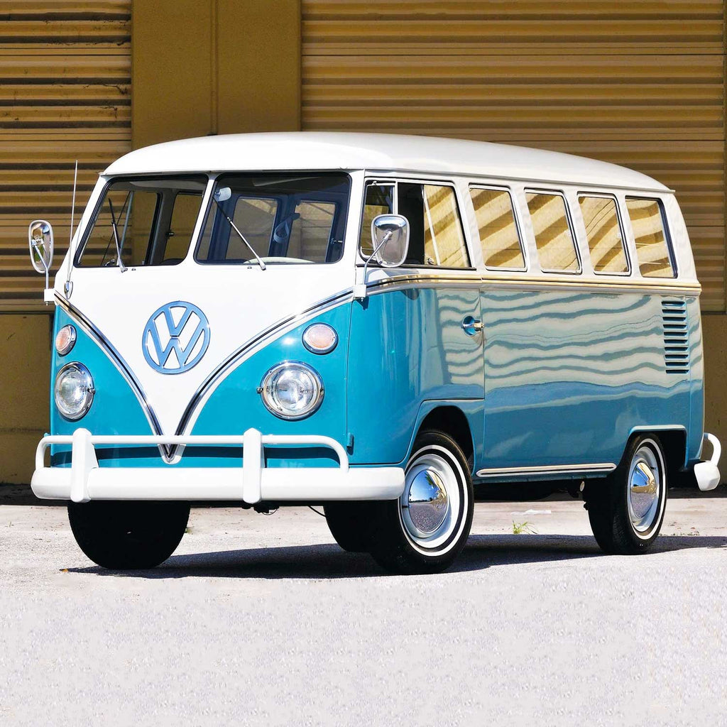 Image of a classic blue and white, split-window VW camper van