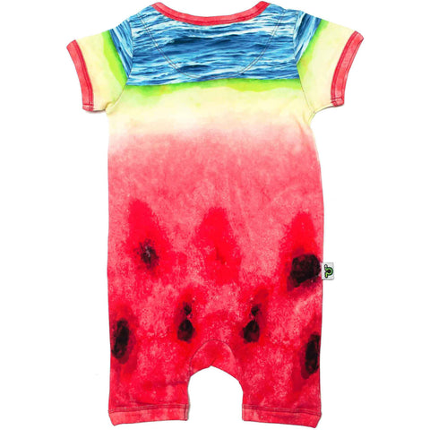 Back view of short sleeve romper with shorts printed with an oversized image of a watermelon slice and ocean waves