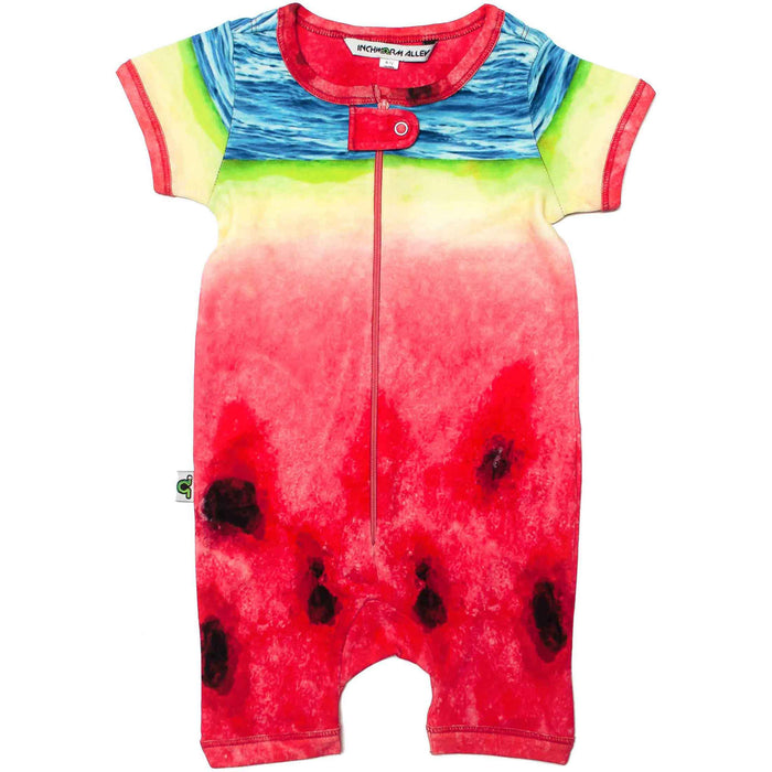 Front view of short sleeve romper with shorts printed with an oversized image of a watermelon slice and ocean waves