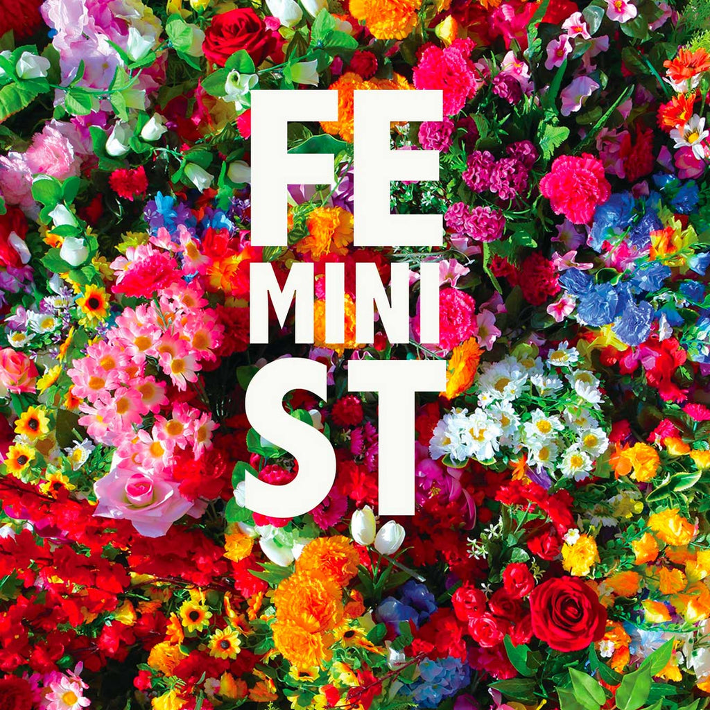 Image of an all-over print of multicoloured flowers with the text feMINIst