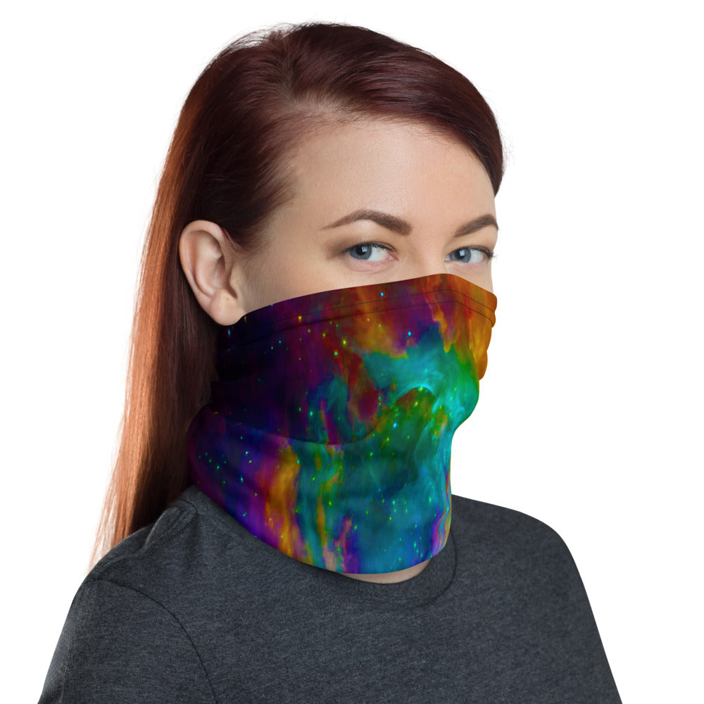 Woman wearing a cloth face mask in a brightly coloured Orion Nebula print
