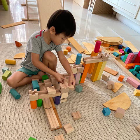 Liam, 4 years, building Cuboro marble run.