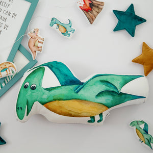 baby room decor with pterodactyl cushion, turquoise pillows in boys room
