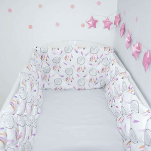 Quilted crib bumpers with pink dream catchers