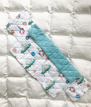 Baby changing mat with rockets and rovers