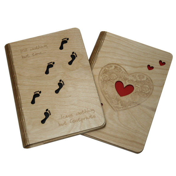 Image of 2 A5 Jimagination Creations wooden notebook covers with a footprint and a heart design on.