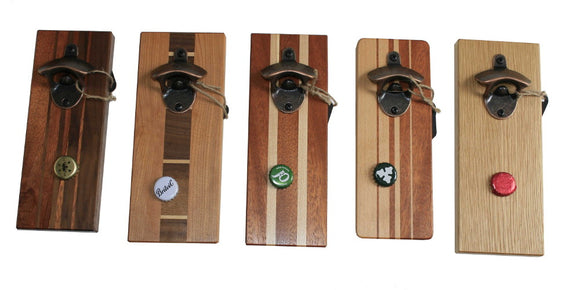 Image of 5 wooden bottle openers of different types of hardwood with magnetic bottle top catches.