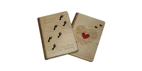 Image of 2 A5 sized wooden notebook covers, one with a footprint design the other with a heart design.