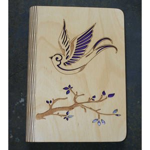 wooden writting notebook cover with a bird and branch design