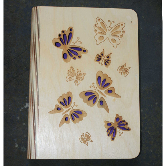 wooden note book cover with a butterflies design