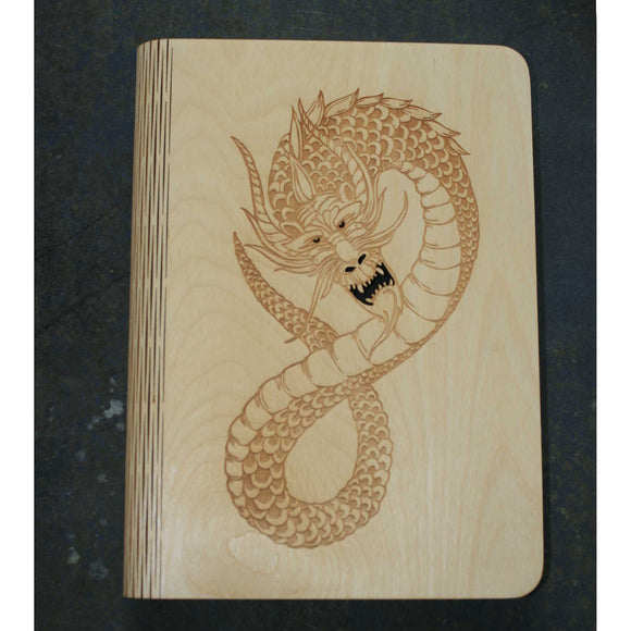 wooden note book cover with a dragon design