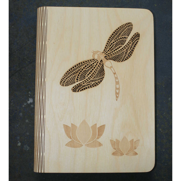 wooden note book cover with a dragonfly design
