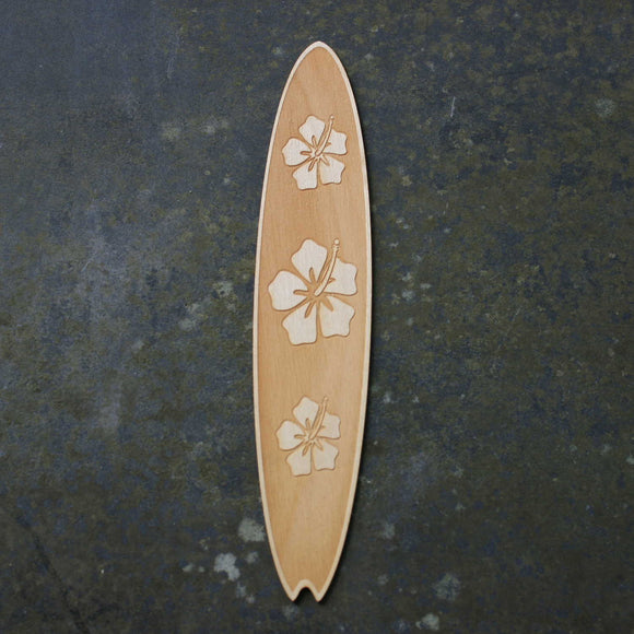 Wooden bookmark of a surfboard with a flower design