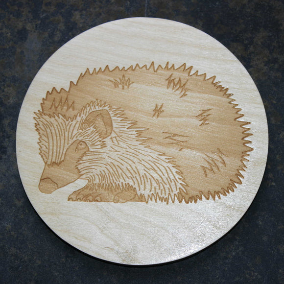 Wooden coaster with a hedgehog design