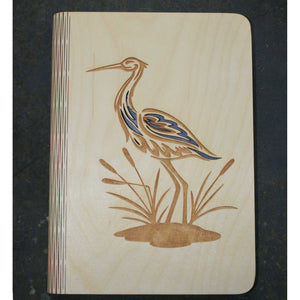 wooden book cover with a heron design