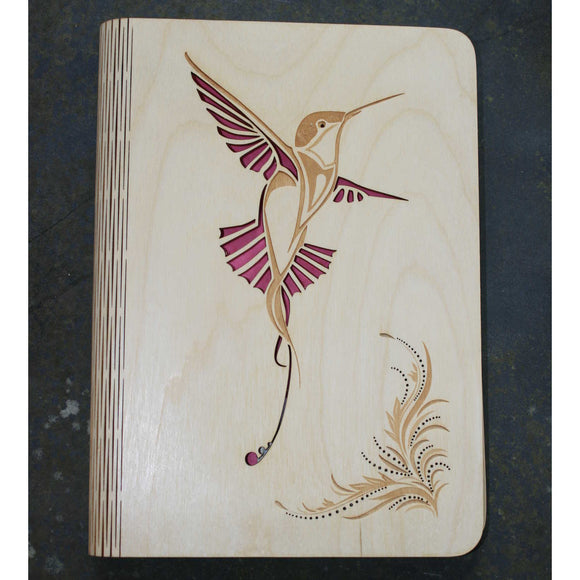 wooden note book cover with a hummingbird design