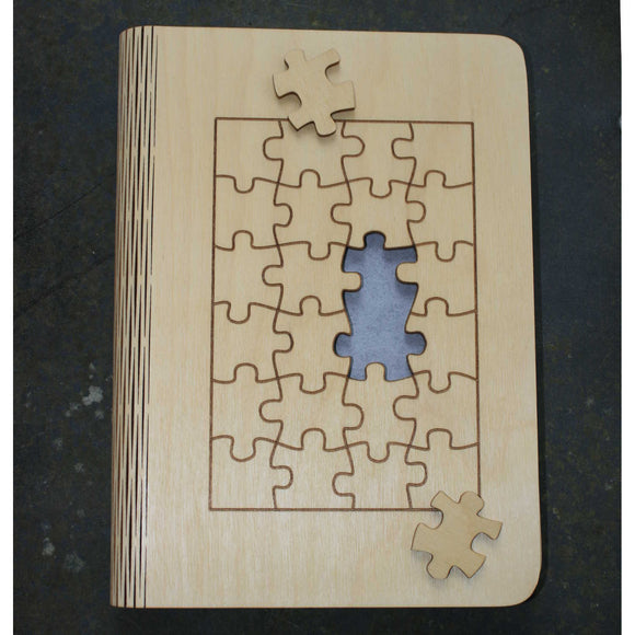 wooden note book cover with a jigsaw puzzle design