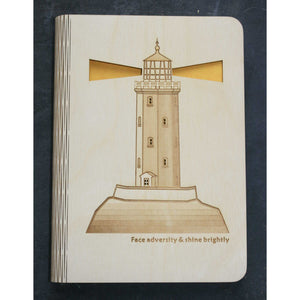 wooden note book cover with a lighthouse design