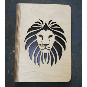wooden note book cover with a lion's head design