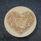 Wooden coaster with a lace heart design